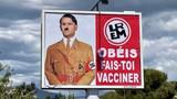 Macron'un Hitler'e benzetildiği afişi asana 10 bin euro ceza