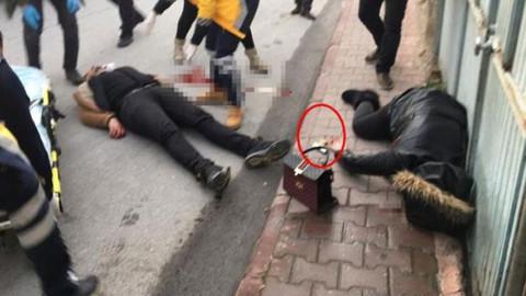 Eşini sokak ortasında öldürdü