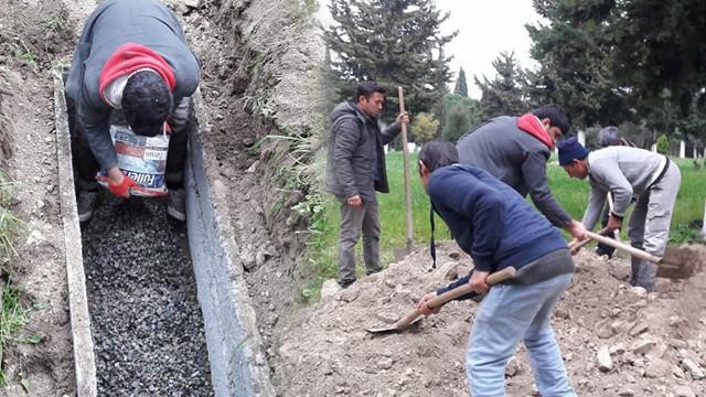 Beton ölen babasının mezarına beton döktü