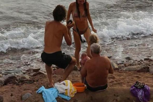 Rus turist denizde doğurdu, balkondan o anları kaydetti - Page 1